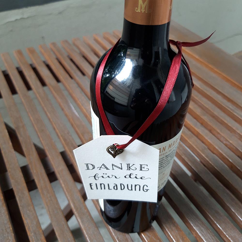 Foto Danke für die Einladung mit Flasche